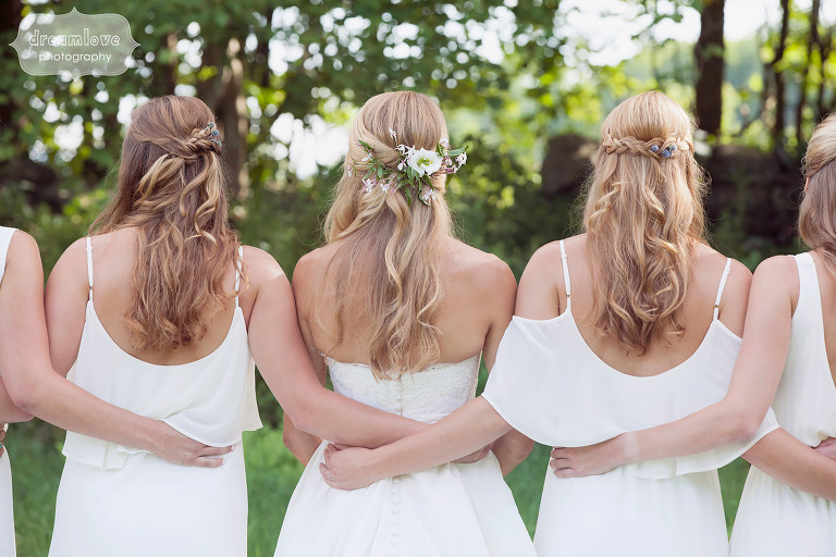 Fine art wedding photo of the back of the bridesmaids dresses at the 1824 House in VT.