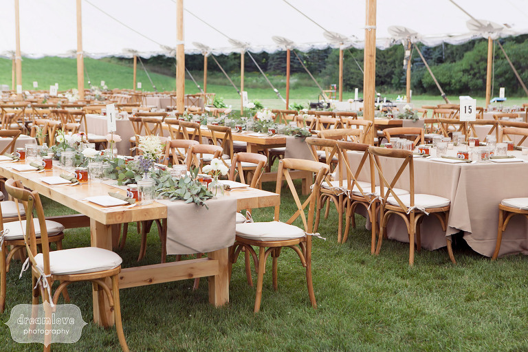 Dinner tables set up for rustic tented reception at the 1824 House in VT.