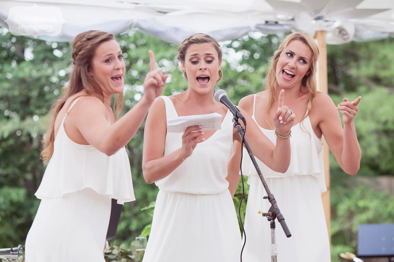 Funny photo of the bridesmaids giving a lip sync toast performance at the 1824 House in VT.
