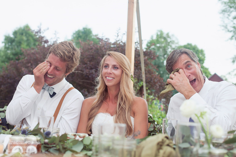 Best documentary wedding photo of the bride crying with her groom and father during the speeches at her 1824 House wedding in Waitsfield, VT.