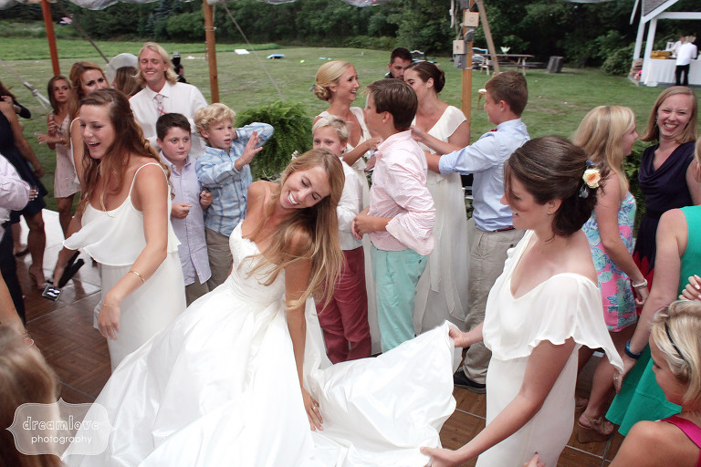 Great documentary photo of the bride kicking her dress out while dancing at the reception of her 1824 House wedding in VT.