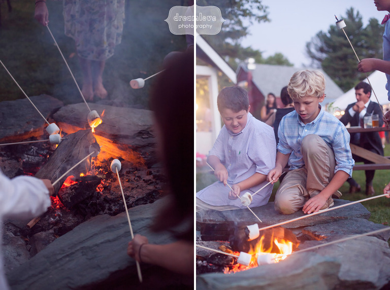 Kids roast smores over a campfire at this rustic wedding at the 1824 House in Waitsfield, VT.
