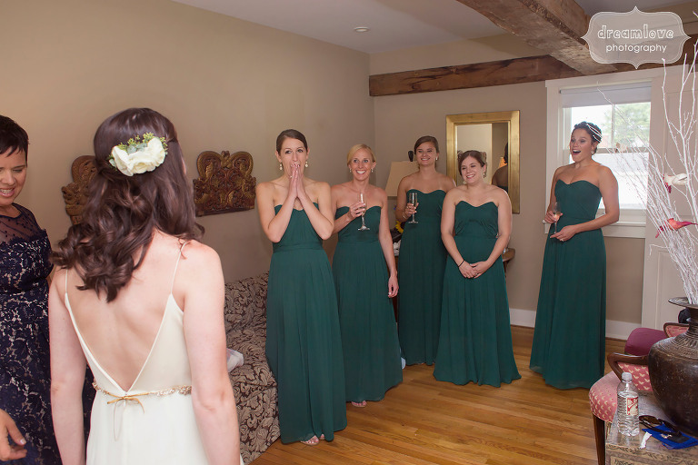 Great documentary moment of the bridesmaids seeing the bride for the first time at the Woodbound Inn, NH.