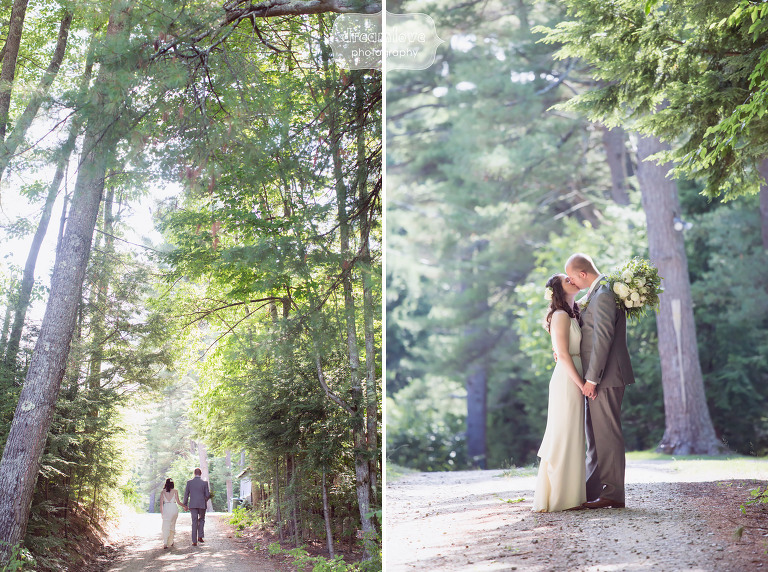 Bride and groom walking down a woodsy path at the Woodbound Inn wedding venue in Rindge, NH.