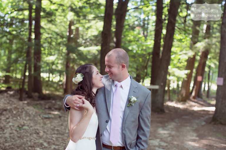 Candid photo of the bride and groom at the Woodbound Inn camp wedding venue in NH.