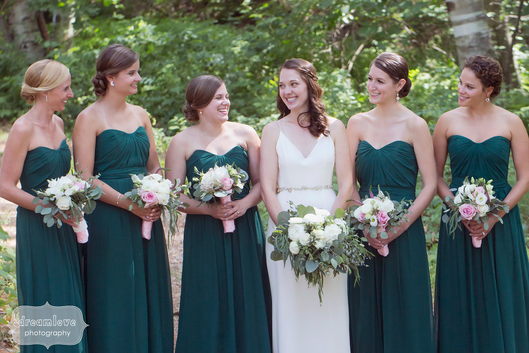 Bridesmaids in evergreen dresses at the Woodbound Inn in NH.