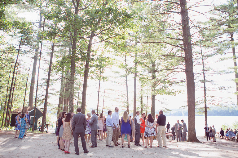 Guests gather by the lake before the outdoor ceremony at the Woodbound Inn in NH.