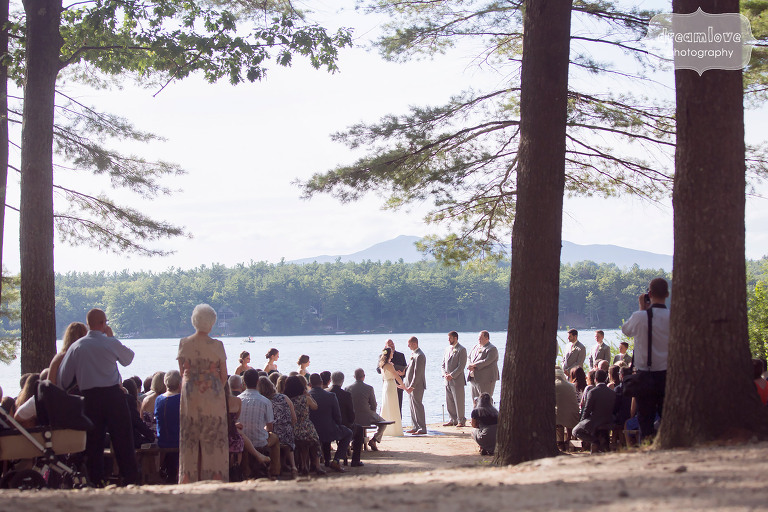 Lakeside wedding ceremony photo at this camp wedding venue at the Woodbound Inn, NH.