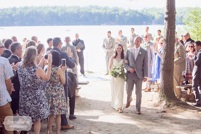 The bride and groom exit the ceremony during the recessional at the Woodbound Inn, NH.
