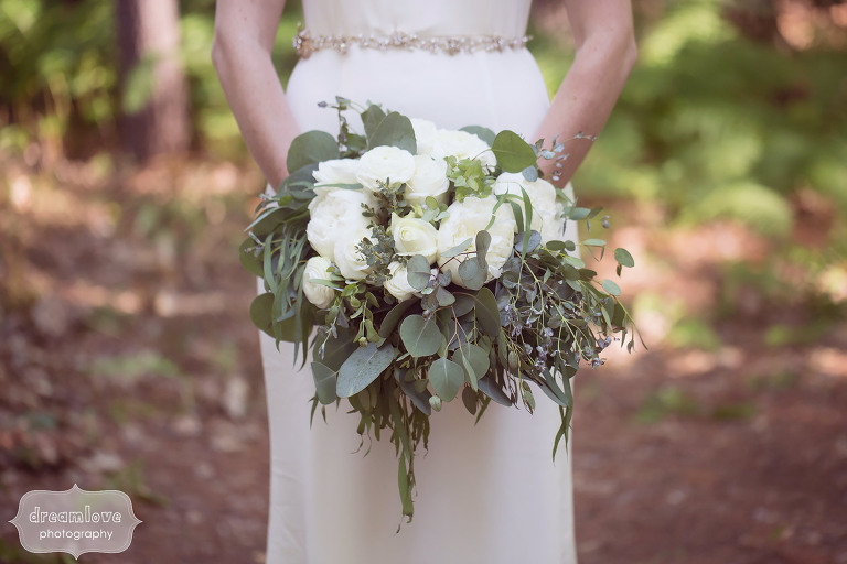 Bride holding bouquet at the Woodbound Inn in southern NH.