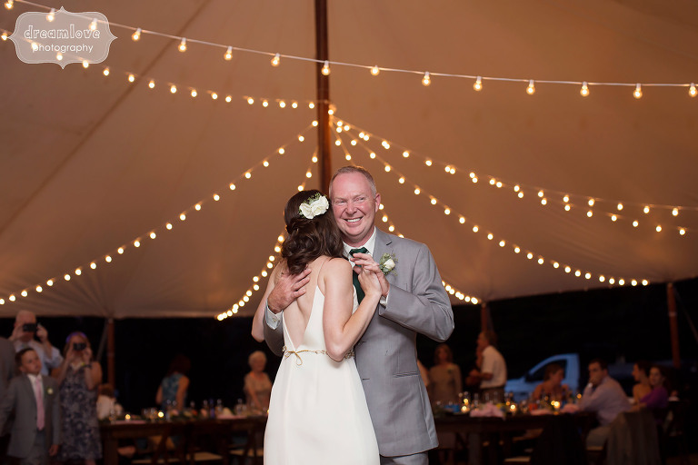 Father daughter dance under string cafe lights at the Woodbound Inn, NH reception.