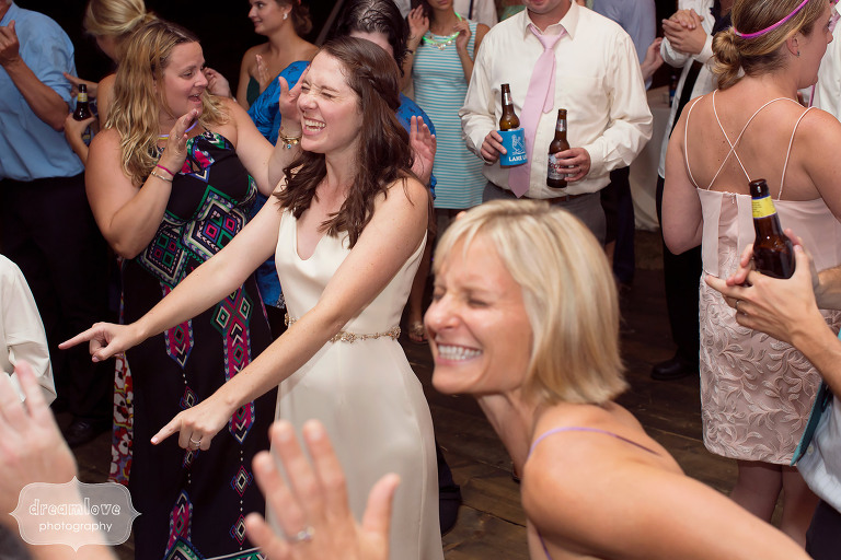 Funny photo of the bride dancing in the reception tent at the Woodbound Inn in NH.