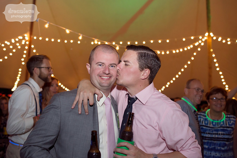 Groom gets kissed during wedding reception at the Woodbound Inn in NH.