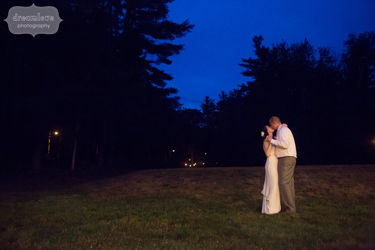 Magical wedding photo of the bride and groom under the twilight at the Woodbound Inn in NH.