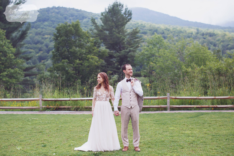 The bride and groom hold hands in this fine art wedding photo from the Topnotch Resort in Stowe, VT.
