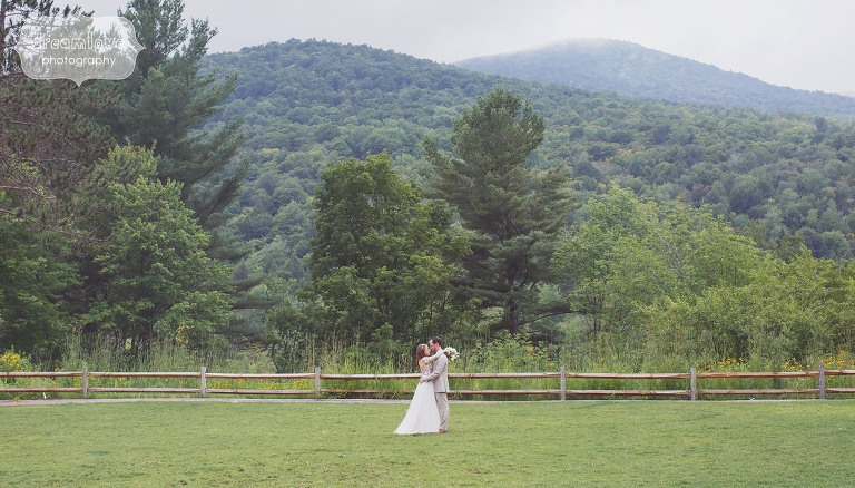 Landscape artistic wedding photo of the bride and groom in VT.