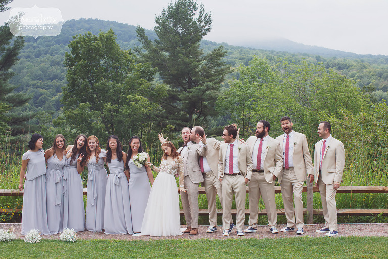 Funny photo of the wedding party in tweed suits and lilac dresses at this rustic Stowe, VT wedding.