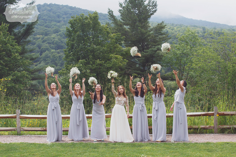 Bridesmaids throw their flowers up into the air at the Topnotch Resort in Stowe, VT.