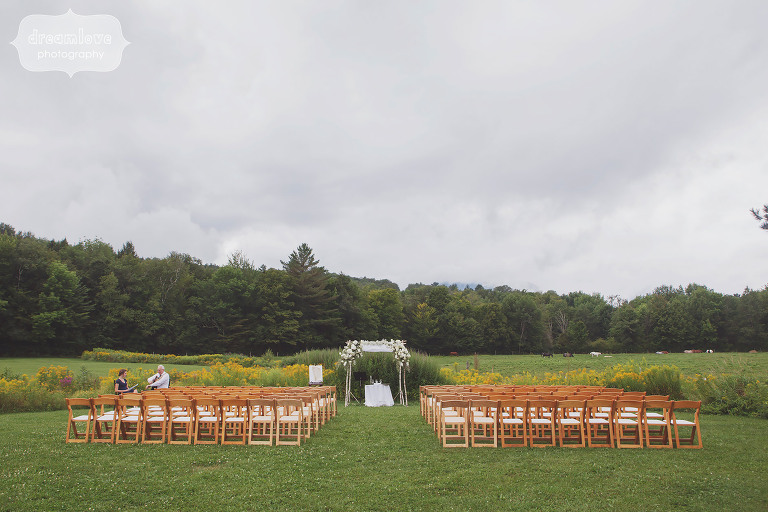 View of the outdoor ceremony space at Topnotch Resort in Stowe, VT surrounded by mountains.