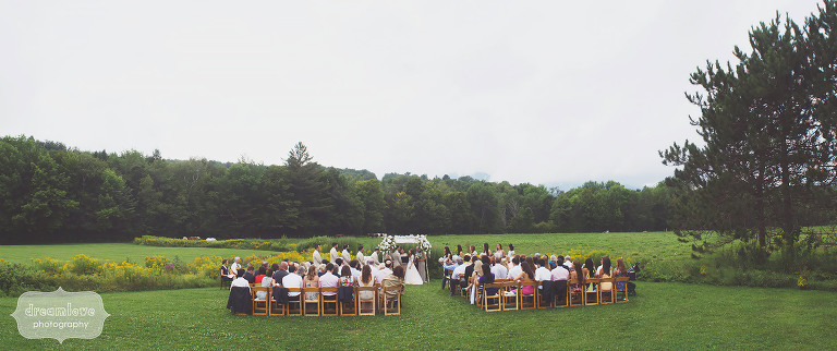 Landscape artsy photo of the field ceremony site at a Topnotch Summer wedding in Stowe, VT.