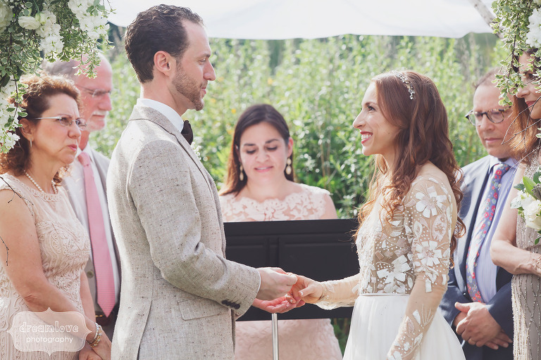 The bride and groom read their vows during their outdoor wedding in Stowe, VT.