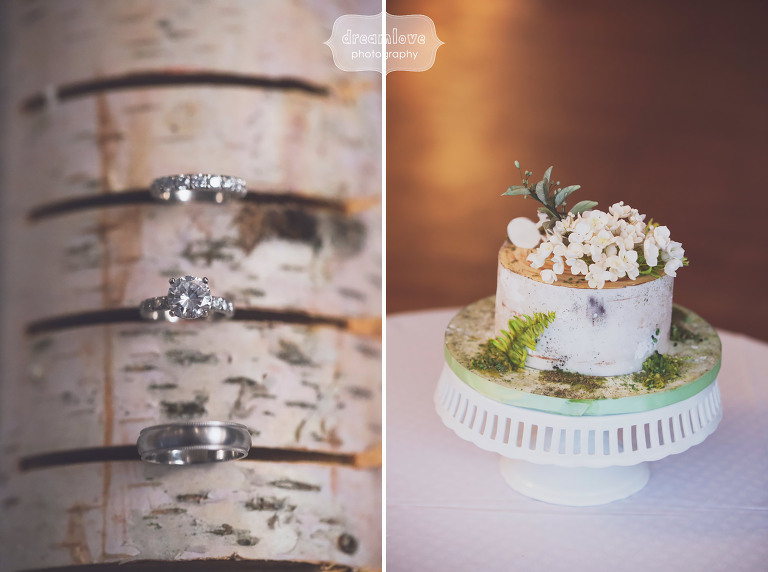 Vintage wedding details with porcelain cake stand and birch log with wedding rings at Topnotch in Stowe, VT.