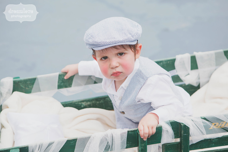Funny photo of surly ring bearer in wagon at this Topnotch wedding in Stowe, VT.