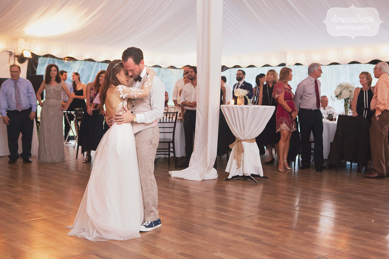 The bride and groom have their first dance in the tent at Topnotch in Stowe, VT.