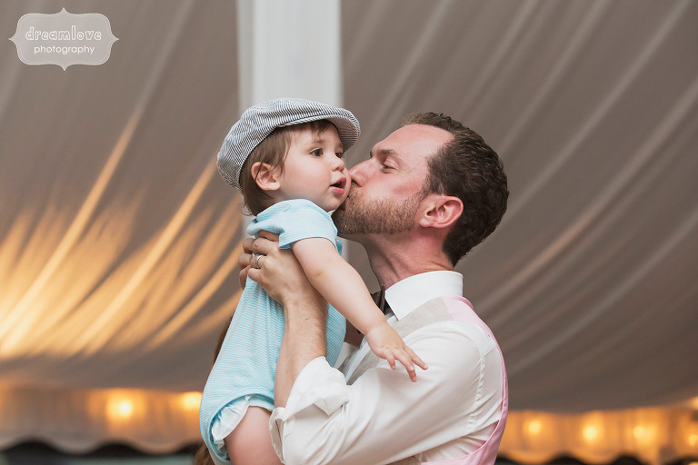 The groom kisses a toddler wedding guest at the Topnotch Resort in Stowe, VT.