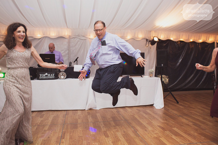 A funny photo of the father of the bride jumping during a dance at Topnotch in Stowe, VT.