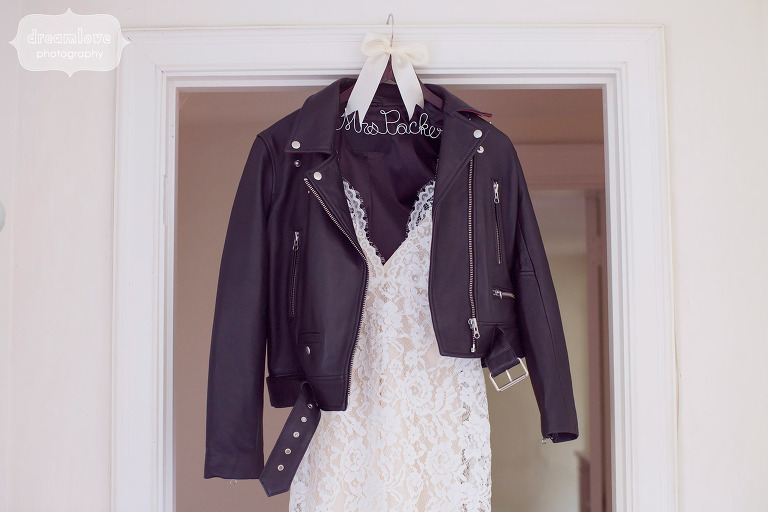 Alternative photo of wedding dress hanging with leather jacket