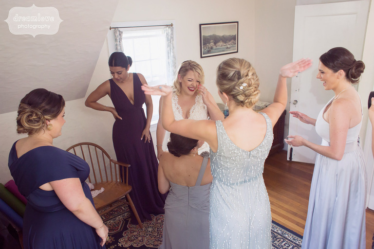 Bridemaids laughing with the bride at the Overbrook House in MA
