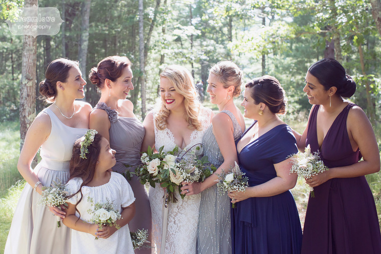 Ethereal wedding photography of the bride with her bridesmaids in the woods on Cape Cod.