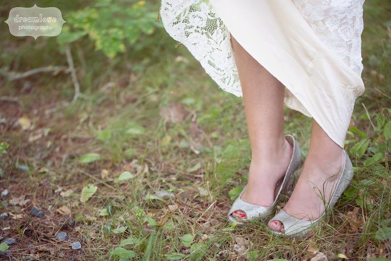 Bride wearing Badgley Mischka peep toe sparkle shoes.