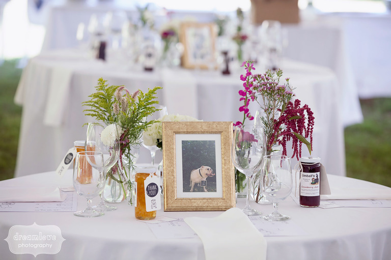 Rustic Cape Cod wedding centerpieces with framed table numbers and jewel toned flowers.