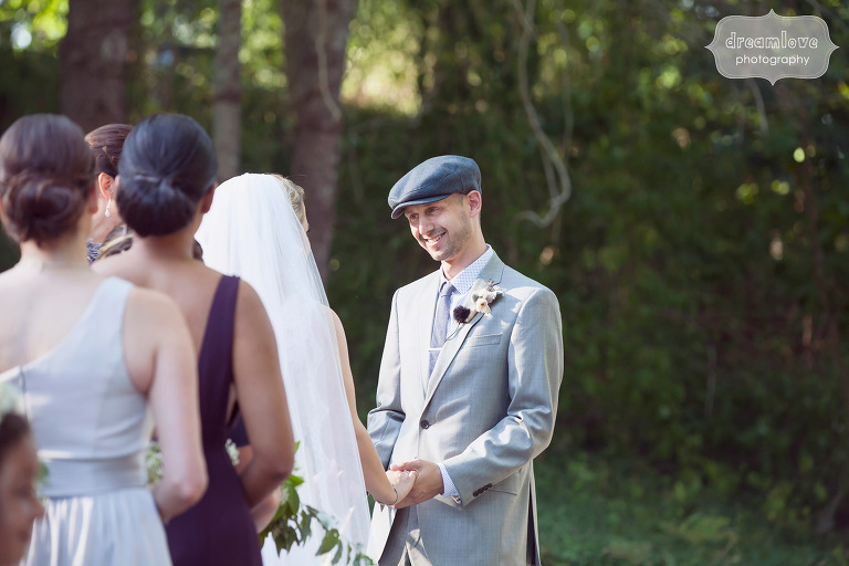 Documentary photo of the groom during the outdoor ceremony at Cape Cod, MA.