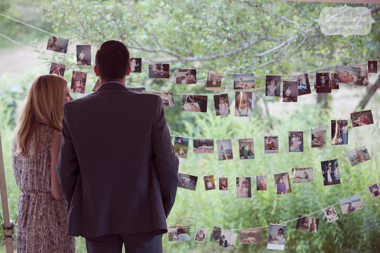 Old family photos strung up as decor at this Cape Cod wedding.