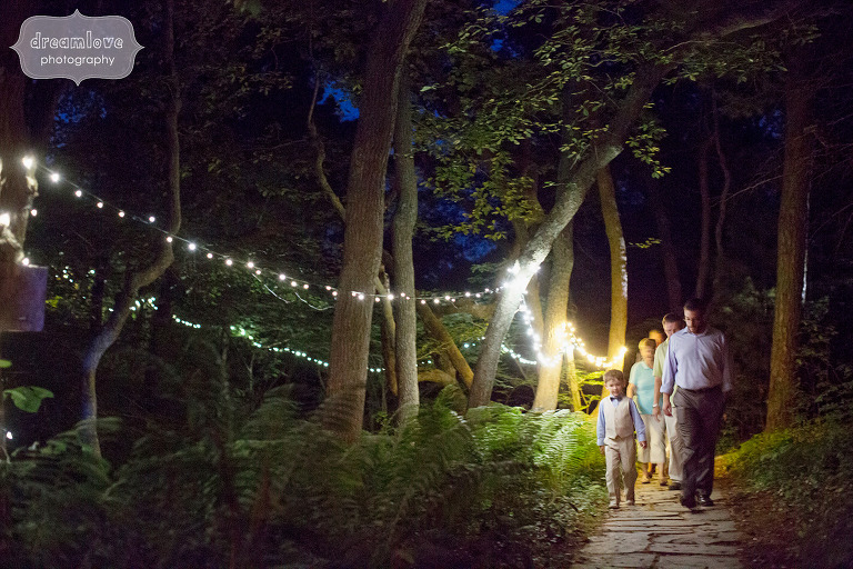Guests walk down the path at the Overbrook House with twinkle lights.