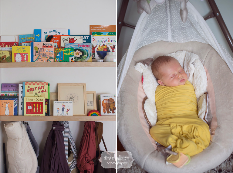 Unique baby portrait with baby books and in a yellow swaddle.