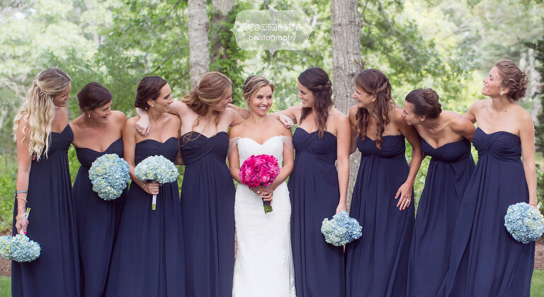 Bride with her bridesmaids at this woodsy Cape Cod wedding in MA.