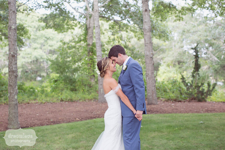 Sexy pose of bride and groom before their Cape Cod wedding in W. Yarmouth.
