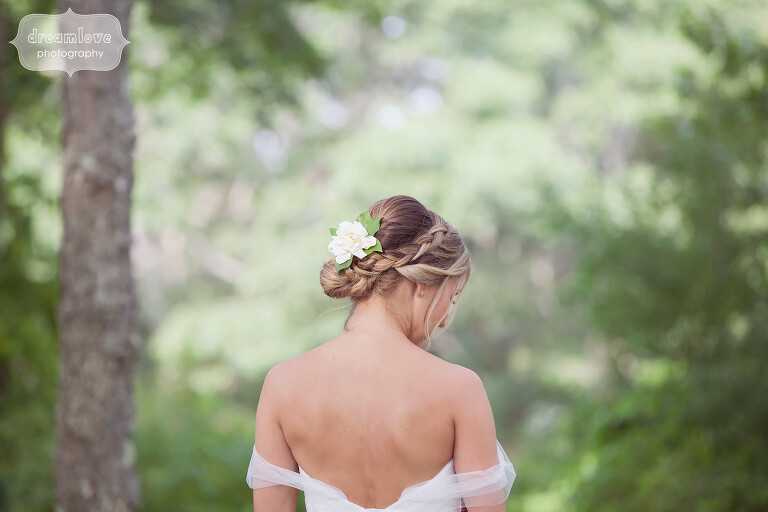 Beautiful bride with freesia flower in her hair with braid on Cape Cod.