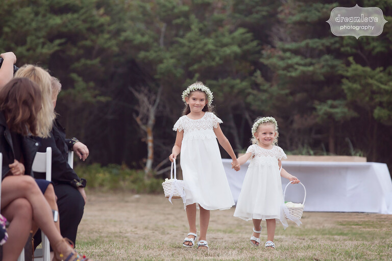 Adorable flower girls hold hands for Cape Cod wedding.
