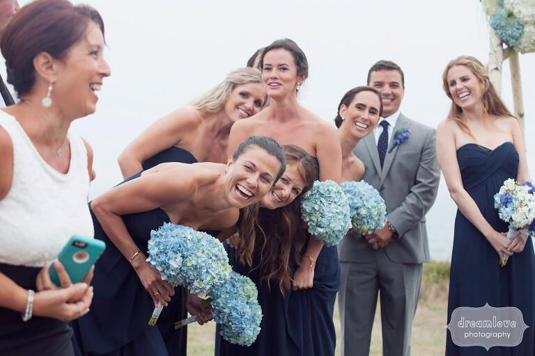 Documentary wedding photo of bridesmaids on Cape Cod.