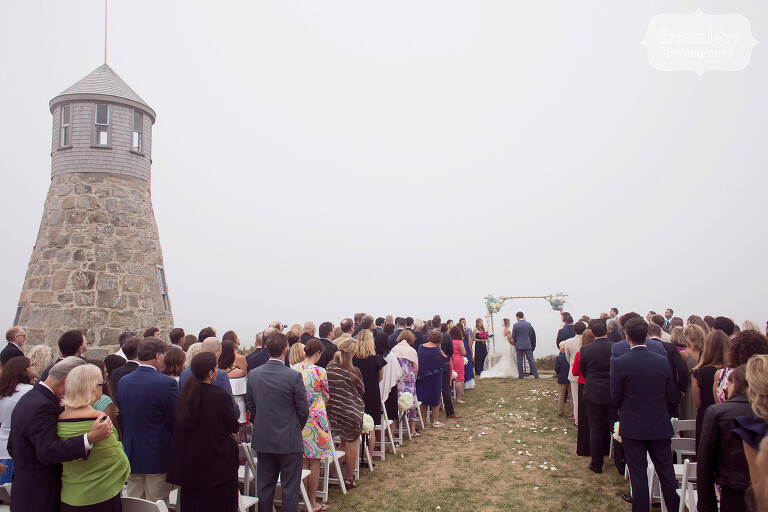 Point Gammon lighthouse wedding ceremony on the beach on Cape Cod.