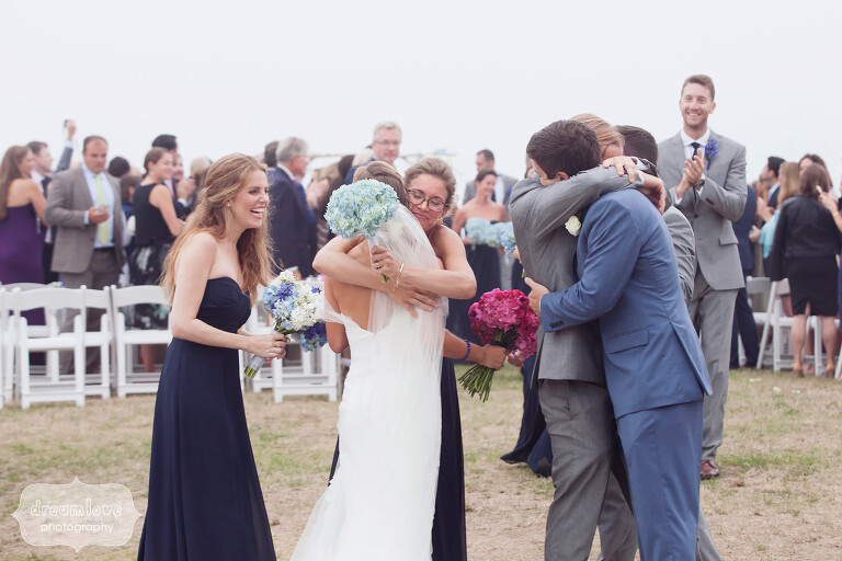 Wedding guests congratulate the bride and groom during Cape Cod wedding.