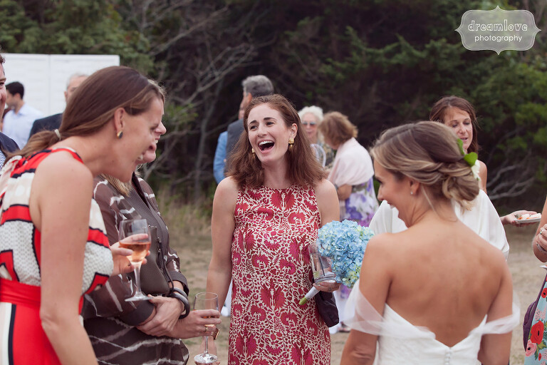 Candid wedding photography of guests during cocktail hour on Cape Cod.