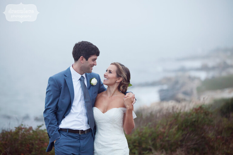 Bride and groom on the shore for their ocean wedding on Cape Cod.