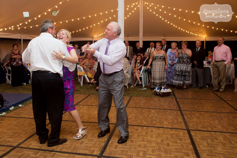 Funny dancing photo of greek wedding tradition with throwing money.