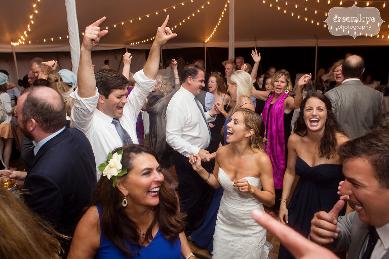 Documentary wedding dance photos of bride and groom at Cape Cod tented reception.